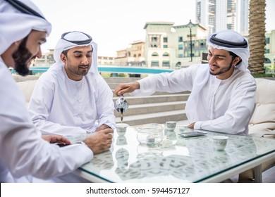 Three arabic men bonding outdoors - Businesspeople having a meeting in a bar restaurant