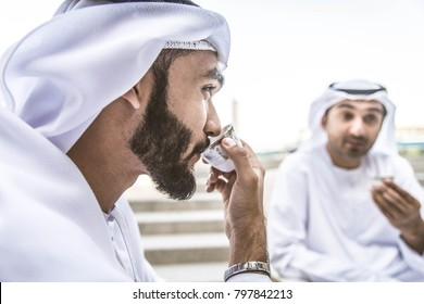 Three arabic men bonding outdoors - Businesspeople having a neeting in a bar restaurant
