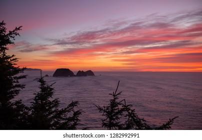 Three Arch Rocks at sunset on the Oregon Coast, a National Wildlife Refuge near Oceanside