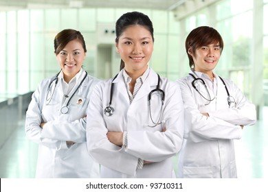 Three Asian doctor wearing a white coats with stethoscope's.