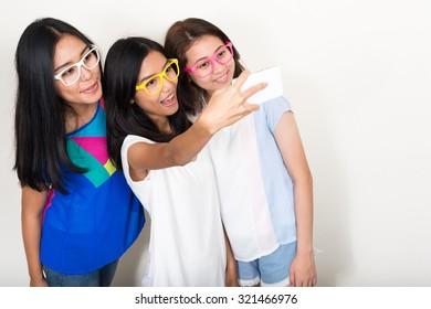 Three Asian girls taking self portrait