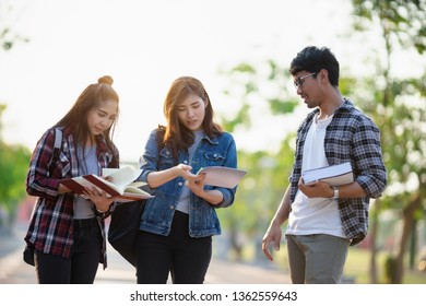 Three Asian peoples portrait, Overseas students smile and fun in park at university. Life of studying and friendship concept.
