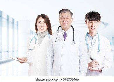 three Asian surgery doctors in hospital