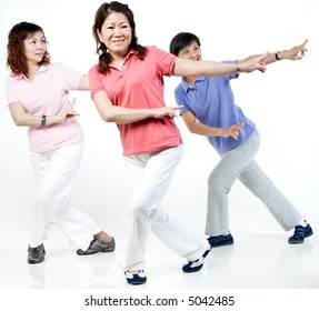 Three Asian women working out together in the studio