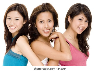 Three attractive young asian women in casual clothes
