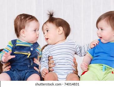 Three babies communicating