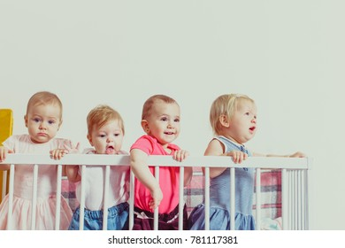 Three baby girls in the crib