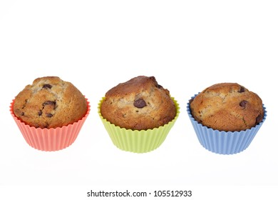 Three Banana Chocolate Chip muffins in colourful silicone cases. Room for your text.