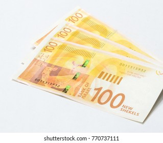 Three banknotes of a new type with a portrait of poet Lea Goldberg worth 100 Israeli shekels isolated on a white background