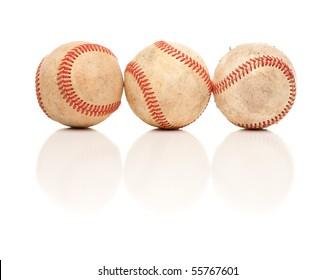 Three Baseballs Isolated on a Reflective White Background.