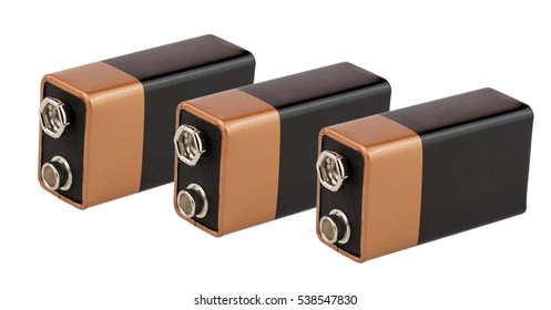 Three batteries, type PP3, unmarked, on white background, isolated