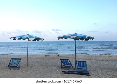 Three beach-chair and two beach umbrella on a sandy beach.Holiday relax vacation concept.