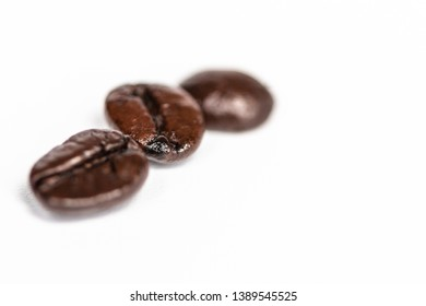 Three beans of roasted coffee beans