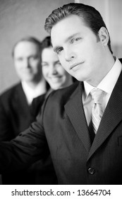three beautiful attractive businesspeople in formal clothing standing in line smiling looking at camera
