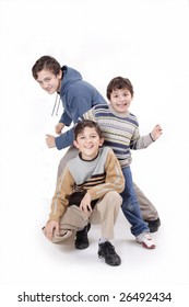 three beautiful and cheerful boys playing on the white background