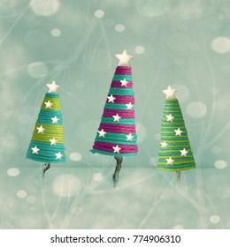Three beautiful colorful cones shape Christmas trees