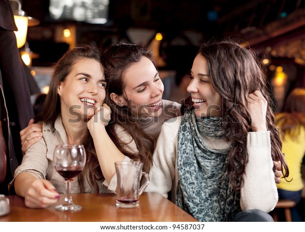 Three beautiful girls in a bar