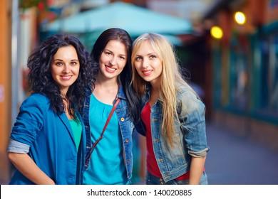 three beautiful girls on evening street