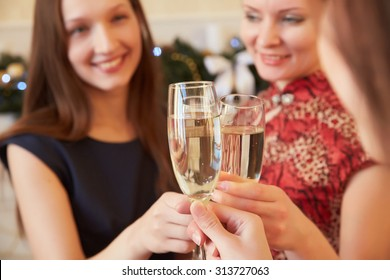 three beautiful girls on New Year's party with champagne