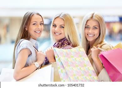 Three beautiful girls in shop