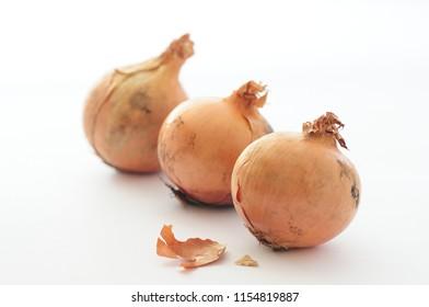 Three beautiful raw golden onions