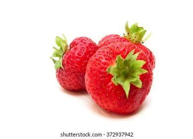 three beautiful ripe strawberries isolated on white