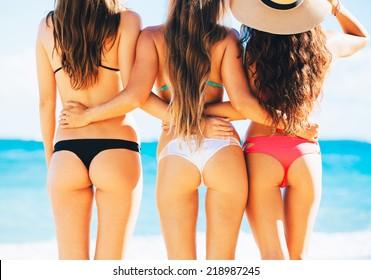 Three Beautiful Sexy Girls in Bikinis on the Beach