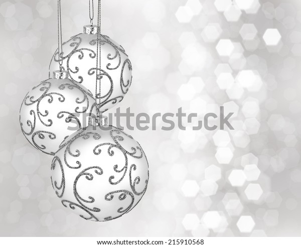 Three beautiful silver christmas balls on a silver background