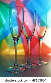 Three beautiful wine glasses with lighted background