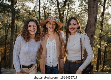 Three beautiful young caucasian women portrait. Smiling girls looking at the camera. Friendship and memories concept.