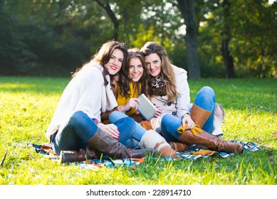 Three beautiful young women in the park