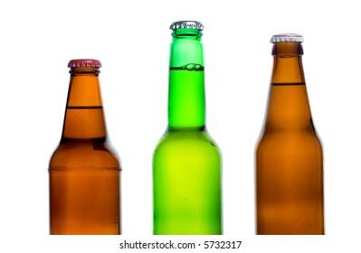 Three beer bottles against white background