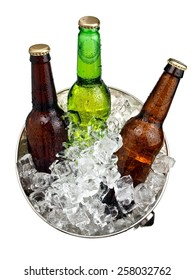 Three beer bottles in a bucket with ice, top view