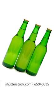 Three beer bottles on white background.