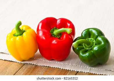 Three bell peppers on the Soft cloth background