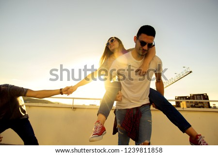 Three Best Friends Relaxing On Rooftop Stock Photo Edit Now