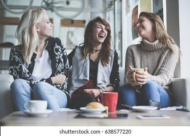 Three best friends. Young women having conversation.
