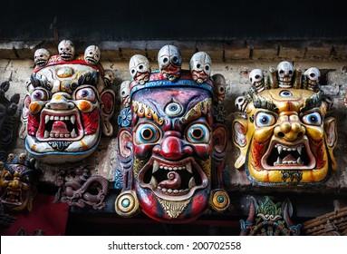 Three Bhairab masks on the wall in the shop in Bhaktapur, Kathmandu valley, Nepal