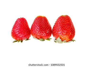 Three big fresh strawberry in a row isolated on white background