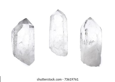 Three big natural quartz crystals isolated on white.