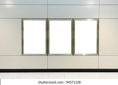 Three big vertical / portrait orientation blank billboard on modern white wall