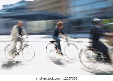 three biker drive in the modern city