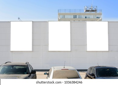 three Bilboards on a facade, place for text