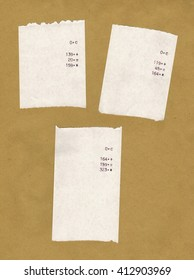 Three bills or receipts isolated over light brown background