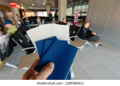 Three biometric passports with tickets for plane or boarding passes