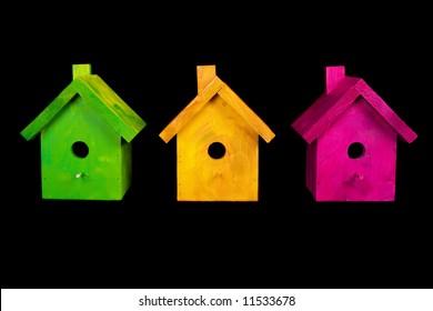 Three birdhouses on black background