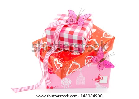 Three Birthday Gifts Wrapped In Red And Pink Wrapping Paper Ribbon Butterfly