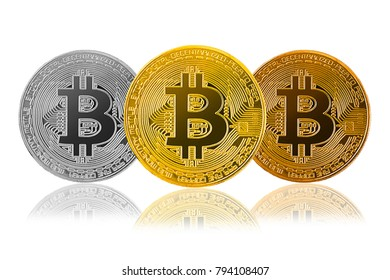 three bitcoin (gold, silver, bronze) isolated on white background; cryptocurrency physical bitcoin coins