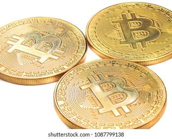 Three bitcoins isolated on white