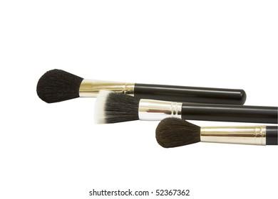 three black make-up brushes  isolated on white